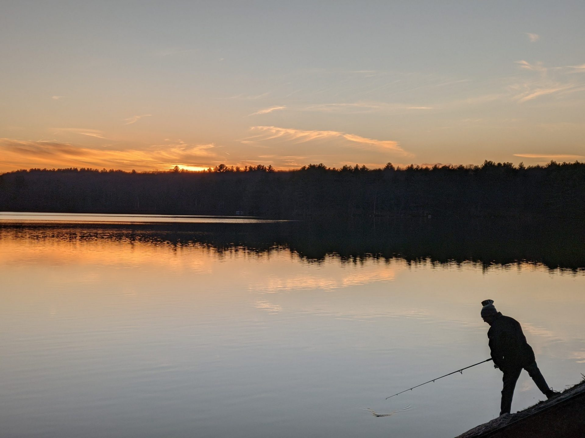 Fisherman in silhouette - sunset Ashland State Park November 2020